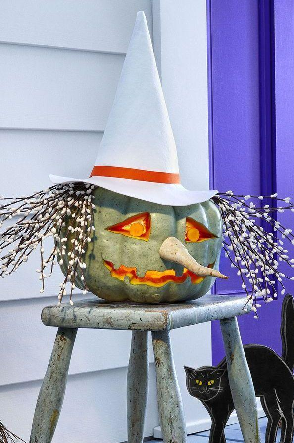 """<p>This witch is ready to put a spell on everyone who comes to your door. To make her, hallow out a green heirloom pumpkin and carve a mouth and eyes. Attach a parsnip nose with toothpicks and straight-pin faux berry branches on top for hair. <a href=""""https://www.womansday.com/home/crafts-projects/g3200/halloween-2017-templates/"""" rel=""""nofollow noopener"""" target=""""_blank"""" data-ylk=""""slk:Print this hat template"""" class=""""link rapid-noclick-resp"""">Print this hat template</a> and trace it onto felt; cut out tracing and assemble with hot glue. </p><p><strong>RELATED: </strong><a href=""""https://www.goodhousekeeping.com/holidays/halloween-ideas/a24170356/diy-witch-costume/"""" rel=""""nofollow noopener"""" target=""""_blank"""" data-ylk=""""slk:10 Unique and Easy DIY Witch Costume Ideas to Try Now"""" class=""""link rapid-noclick-resp"""">10 Unique and Easy DIY Witch Costume Ideas to Try Now</a></p>"""