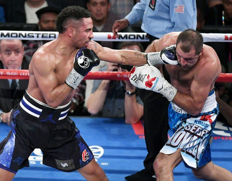 Andre Ward and Sergey Kovalev trade blows during their first fight. (Getty)