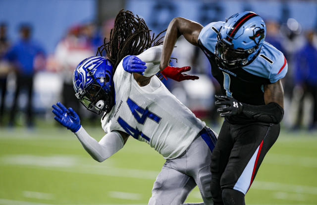 St. Louis Battlehawks safety Joe Powell (44) and Dallas Renegades wide receiver Jazz Ferguson (1) collide during an XFL football game. (AP Photo/Brandon Wade)