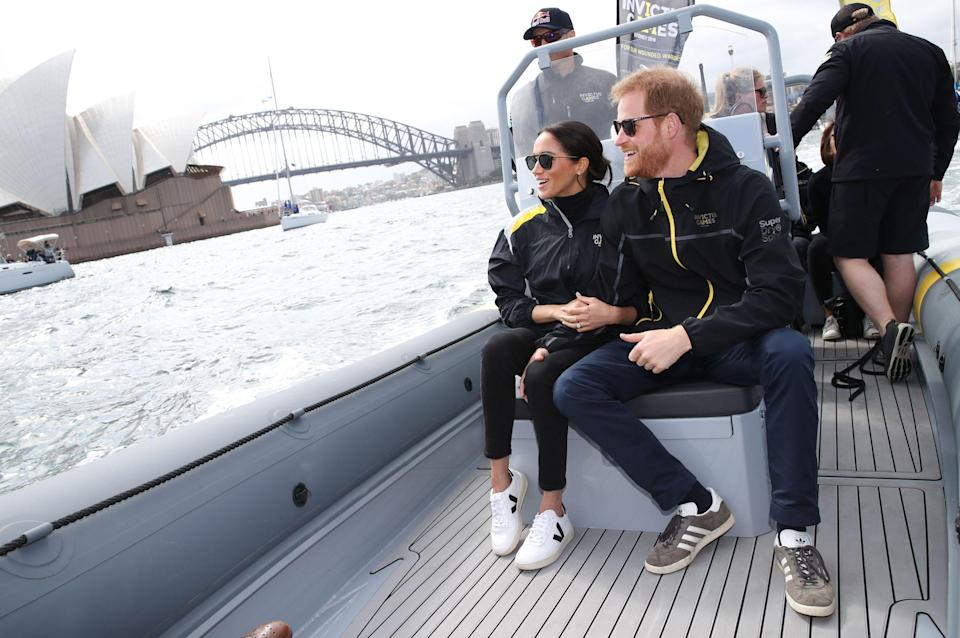 """<p>For a morning of sailing Markle wore an Invictus windbreaker, with <a href=""""https://www.farfetch.com/uk/shopping/women/veja-v-lace-up-sneakers-item-12733948.aspx?storeid=9983&size=37&pid=googleadwords_int&af_channel=Search&c=629762120&af_c_id=629762120&af_keywords=pla-319287226513&af_adset_id=9623625096&af_ad_id=61200815496&is_retargeting=true&shopping=yes&gclid=EAIaIQobChMI5LXU74Oa3gIVwuJ3Ch387Ay3EAQYAyABEgL-c_D_BwE"""" rel=""""nofollow noopener"""" target=""""_blank"""" data-ylk=""""slk:Veja trainers"""" class=""""link rapid-noclick-resp"""">Veja trainers</a>, <a href=""""https://adinareyter.com/products/3-diamond-amigos-curve-posts"""" rel=""""nofollow noopener"""" target=""""_blank"""" data-ylk=""""slk:Adina Reyter earrings"""" class=""""link rapid-noclick-resp"""">Adina Reyter earrings</a>, <a href=""""http://clubmonaco.borderfree.com/product/index.jsp?productId=120139286&size=OneSize&color=1174801&SiteId=je6NUbpObpQ-.mREny1dy_Vpu0RNdQG1zA&bfx-cc-countries=GB&bfx-cc-currencies=GBP"""" rel=""""nofollow noopener"""" target=""""_blank"""" data-ylk=""""slk:Krewe sunglasses"""" class=""""link rapid-noclick-resp"""">Krewe sunglasses</a> and unidentified turtleneck and jeans</p>"""