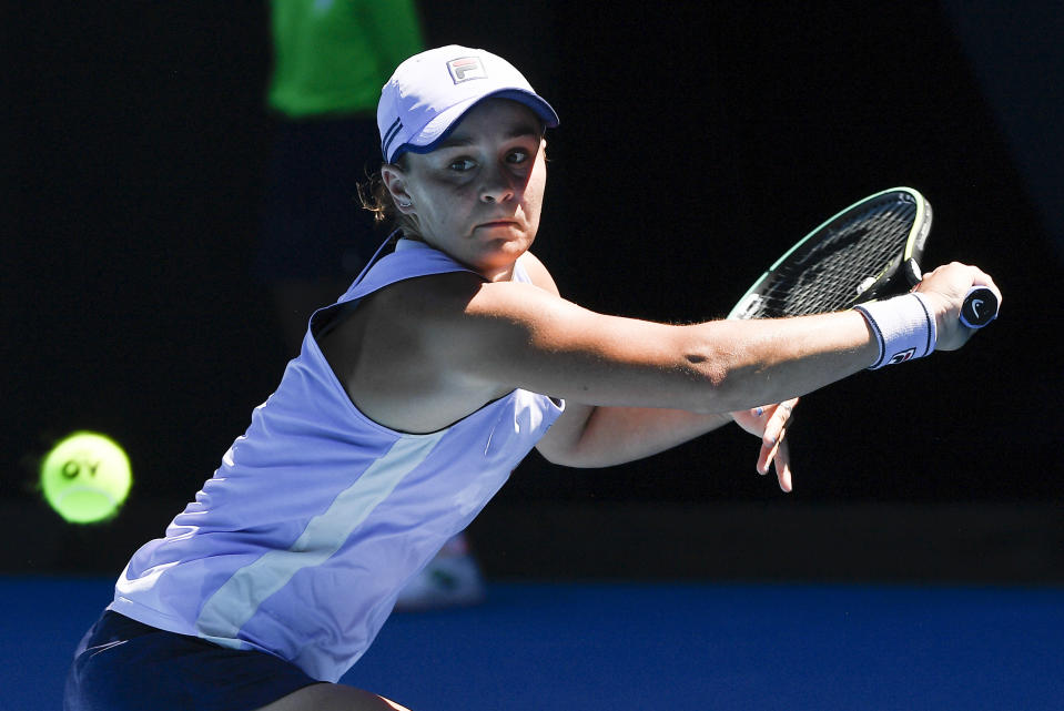 Australia's Ash Barty hits a backhand return to Karolina Muchova of the Czech Republic during their quarterfinal match at the Australian Open tennis championship in Melbourne, Australia, Wednesday, Feb. 17, 2021.(AP Photo/Andy Brownbill)