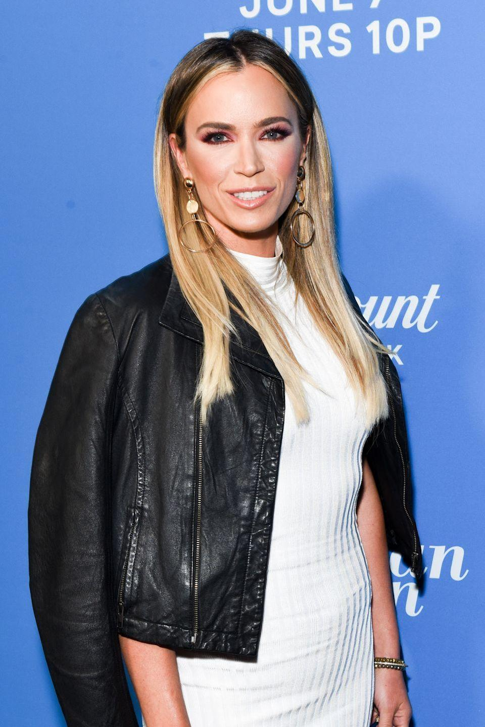 """<p>Teddi Mellencamp is the latest in a string of Housewives to fall from grace. After a rocky season 9 <em>and</em> season 10 on the <em>Real Housewives of Beverly Hills</em>, rumors flurried about her removal from the cast (there were even <a href=""""https://www.change.org/p/bravo-andycohen-fire-kyle-and-teddi-from-rhobh"""" rel=""""nofollow noopener"""" target=""""_blank"""" data-ylk=""""slk:petitions"""" class=""""link rapid-noclick-resp"""">petitions</a>). Shorty after season 10 wrapped, Teddi's weight loss program, All In by Teddi, came under fire when clients claimed that All In would restrict them to eating 500-1,000 calories a day. Alas, it came as no surprise when Teddi announced on Sept. 22, 2020, that her contract had not been renewed a fourth season. </p><p>""""I figured I could give you a little update on what's going on,"""" she shared in the Instagram <a href=""""https://www.instagram.com/p/CFdMJ6bBsqM/"""" rel=""""nofollow noopener"""" target=""""_blank"""" data-ylk=""""slk:video"""" class=""""link rapid-noclick-resp"""">video</a>. """"I recently found out that my contract as a Housewife is not being renewed. Of course I could give you the standard response of, 'Oh we both came to the decision that it would be best.' Nah, I'm not going to do that — that's not who I am. Of course when I got the news I was sad. It feels like a breakup, almost,"""" she said. Hey, at least she's honest! </p>"""