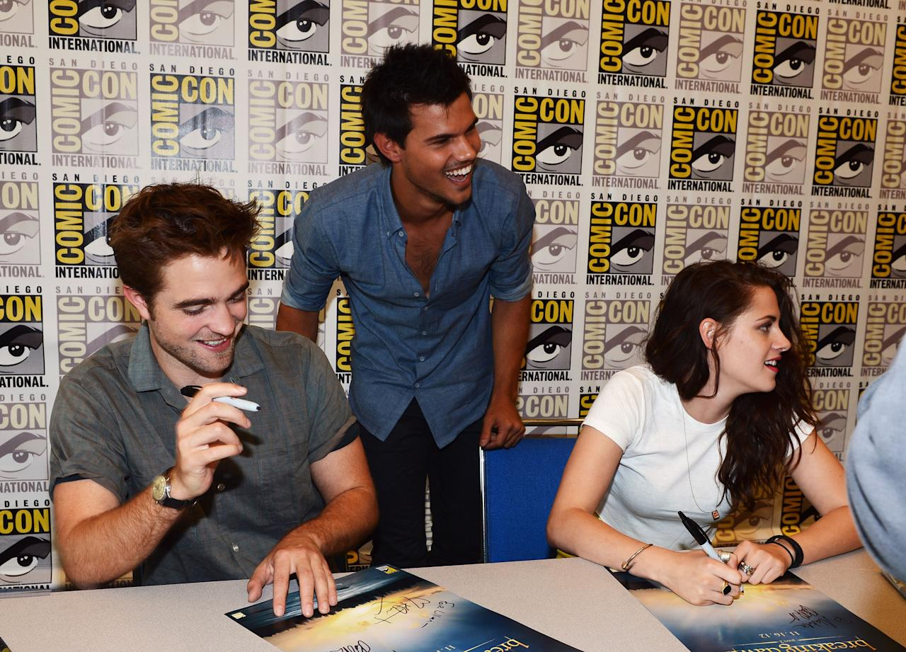 """SAN DIEGO, CA - JULY 12:  (L-R) Actors Robert Pattinson, Taylor Lautner and Kristen Stewart attend """"The Twilight Saga: Breaking Dawn Part 2"""" during Comic-Con International 2012 at San Diego Convention Center on July 12, 2012 in San Diego, California.  (Photo by Michael Buckner/Getty Images for Lionsgate)"""
