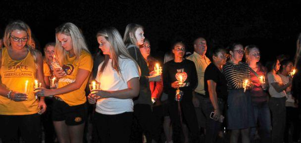 PHOTO: Friends, teammates, students and faculty attend a vigil for former Iowa State golf champion Celia Barquin Arozamena of Spain on the Iowa State campus in Ames, Iowa, Sept. 19, 2018. (Steve Pope/EPA via Shutterstock)