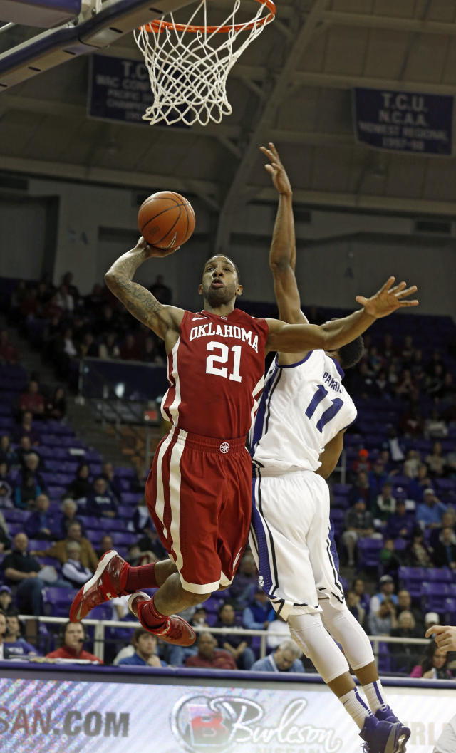 Oklahoma forward Cameron Clark looks for the basket as TCU forward Brandon Parish (11) defends in the first half of an NCAA basketball game Saturday, March 8, 2014, in Fort Worth, Texas. Oklahoma won 97-67. (AP Photo/Sharon Ellman)