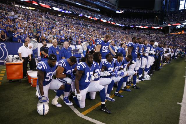 <p>Indianapolis Colts players kneel during the playing of the National Anthem before the game against the Cleveland Browns at Lucas Oil Stadium. Mandatory Credit: Brian Spurlock-USA TODAY Sports </p>