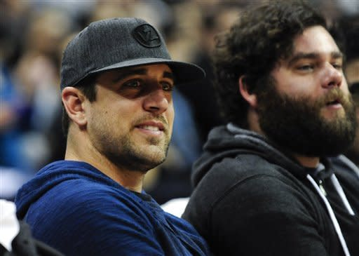 Green Bay Packers NFL football quarterback Aaron Rodgers watches action in the first half of an NBA basketball game between Milwaukee Bucks and Los Angeles Clippers, Wednesday, March 6, 2013, in Los Angeles. (AP Photo/Gus Ruelas)