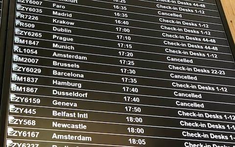 A departure board at Bristol Airport showing flybmi flights cancelled following the collapse of the airline - Credit: PA
