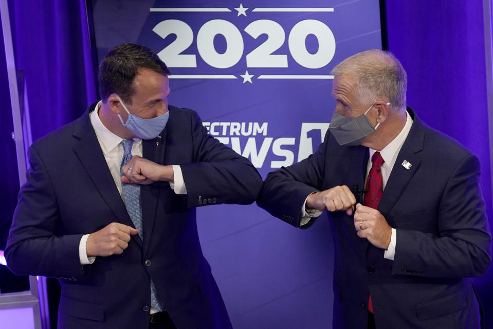FILE - Democratic challenger Cal Cunningham, left, and U.S. Sen. Thom Tillis, R-N.C. greet each other after a televised debate Thursday, Oct. 1, 2020, in Raleigh, N.C. (AP Photo/Gerry Broome, Pool)