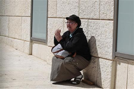 An ultra-Orthodox Jewish woman reacts upon hearing about the death of Rabbi Ovadia Yosef, the spiritual leader of the ultra-religious Shas political party, at Hadassah Ein Kerem Hospital in Jerusalem October 7, 2013. REUTERS/Ammar Awad
