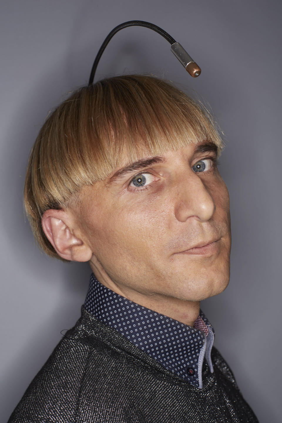 <p>We might not have flying cars yet, but in 2004, Neil Harbisson became the first person to get an antenna implanted into the back of his skull. (PA) </p>