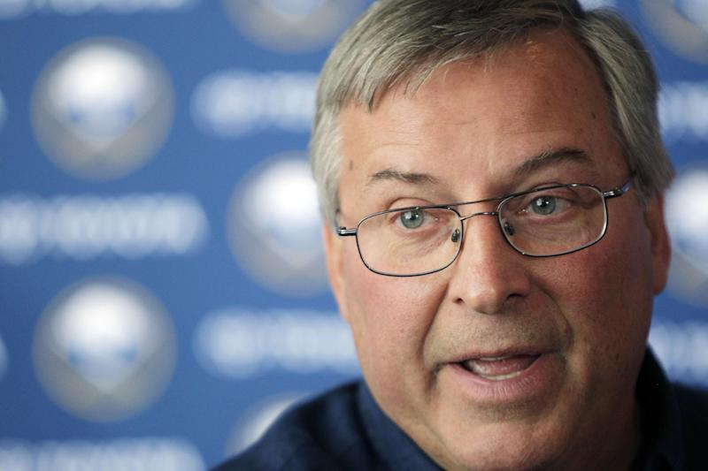 FILE - In this Sept. 15, 2011, file photo, Buffalo Sabres owner Terry Pegula talks with reporters during an NHL hockey news conference in Buffalo, N.Y. Pegula is choosing optimism over making predictions regarding his young, retooled team. (AP Photo/David Duprey, File)