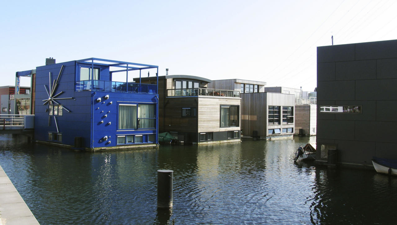In this photo taken Wednesday, March 28, 2012 amphibious homes float on the harbor in the IJburg neighborhood in Amsterdam. IJburg is a new district in the eastern part of town completely surrounded by water. The Netherlands, a third of which lies below sea level, has been managing water since the Middle Ages and has thus emerged as a pioneer in the field, exporting its expertise to Indonesia, China, Thailand, Dubai and the Republic of the Maldives, an Indian Ocean archipelago that with a maximum elevation of about 2 meters (8 feet) is the world's lowest country. (AP Photo/Margriet Faber)