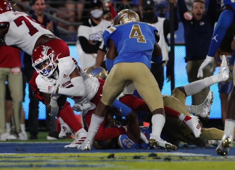 PASADENA, CA - SEPTEMBER 18, 2021: Fresno State Bulldogs wide receiver Jalen Cropper (5) dives into the end zone against UCLA Bruins defensive back Stephan Blaylock (4) at the Rose Bowl on September 18, 2021 in Pasadena, California.(Gina Ferazzi / Los Angeles Times)