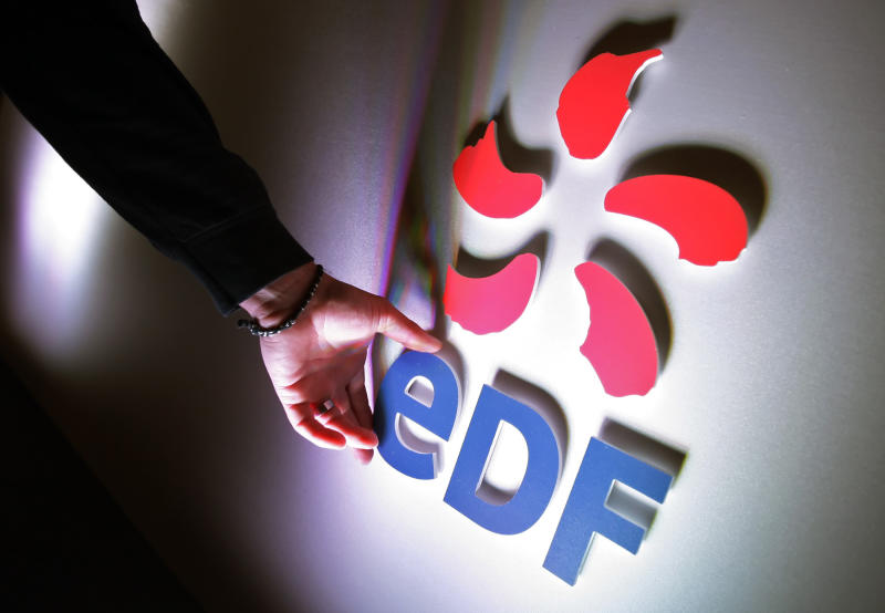 A man adjusts the EDF logo before a press conference in London, September 24, 2008
