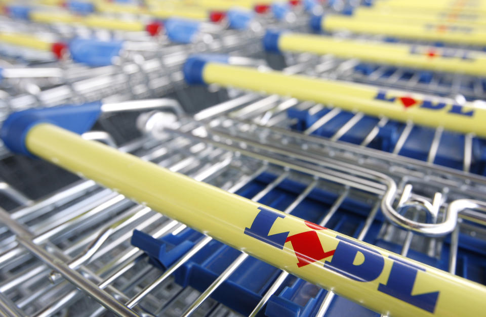 Trolleys are lined up next to the main entrance of the new Lidl supermarket
