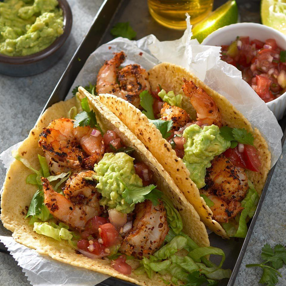 "<p>Give juicy shrimp tacos a Cajun flavor spin with spices and a quick sear on a hot grill. An easy avocado mash adds creaminess to cool off the spicy kick. <a href=""http://www.eatingwell.com/recipe/270116/grilled-blackened-shrimp-tacos/"" rel=""nofollow noopener"" target=""_blank"" data-ylk=""slk:View recipe"" class=""link rapid-noclick-resp""> View recipe </a></p>"