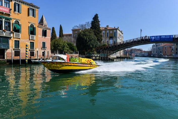 Only an occasional ambulance speedboat is seen in the near-empty city (AFP Photo/ANDREA PATTARO)