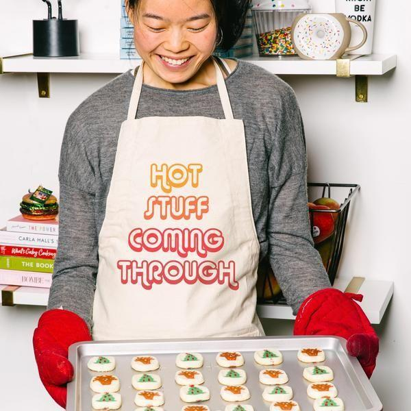 "<p><strong>Delish</strong></p><p>delish.com</p><p><strong>$25.00</strong></p><p><a href=""https://shop.delish.com/products/hot-stuff-coming-through-apron"" rel=""nofollow noopener"" target=""_blank"" data-ylk=""slk:Shop Now"" class=""link rapid-noclick-resp"">Shop Now</a></p><p>Now everyone will know that their cooking skills are on fire.</p>"