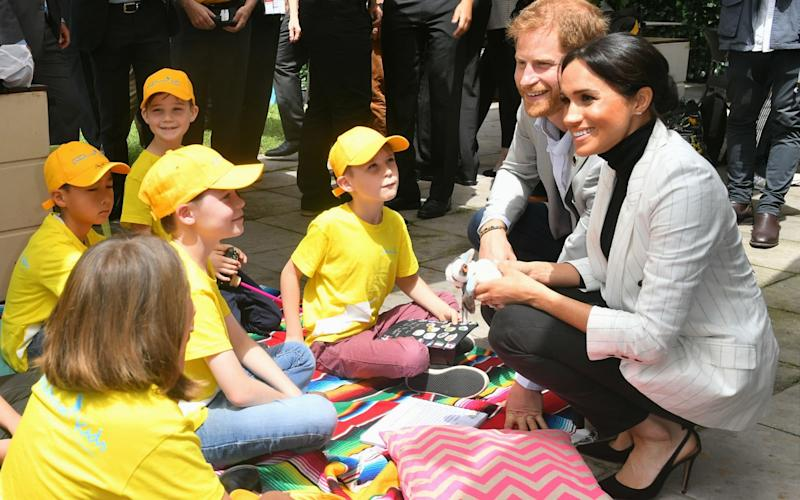 The Duchess of Sussex caught up with Prince Harry for the second event of the day, a reception for children hosted by the Australian Prime Minister - WireImage