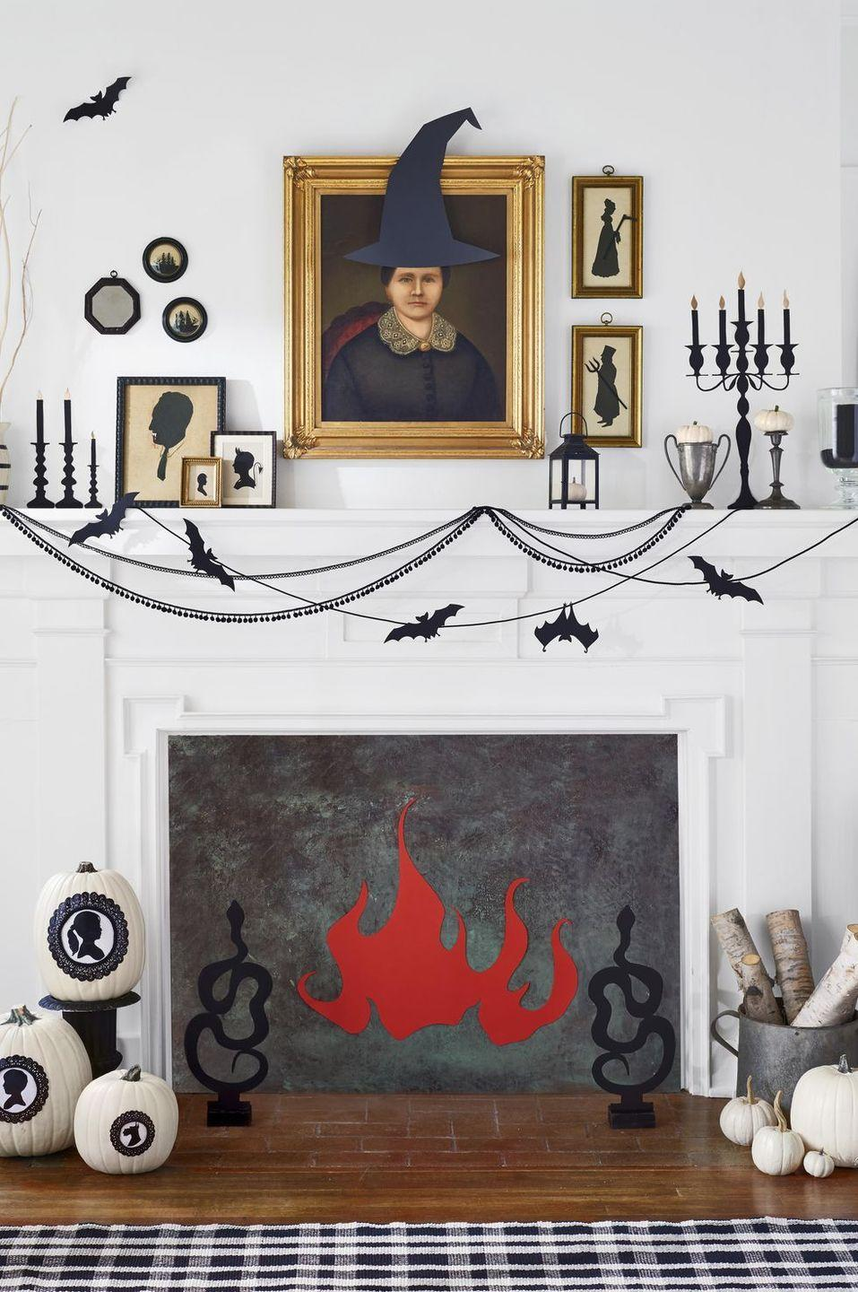 <p>Replace family photos with cut-out silhouettes of Halloween's very best, including the Grim Reaper, Frankenstein, and Count Dracula. Stick 'em in frames, and then hang them on the wall or use them to dress up your mantel. </p>
