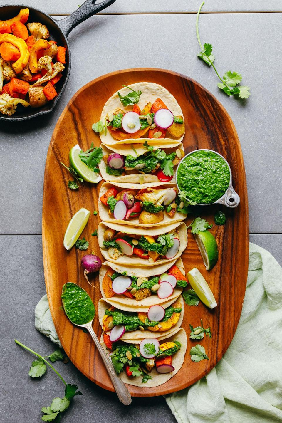 """<p>Chimichurri is good on practically anything, including the roasted veggies in these tacos.</p> <p>Get the recipe <a href=""""https://minimalistbaker.com/roasted-vegetable-tacos-chimichurri/"""" rel=""""nofollow noopener"""" target=""""_blank"""" data-ylk=""""slk:here"""" class=""""link rapid-noclick-resp"""">here</a>.</p>"""