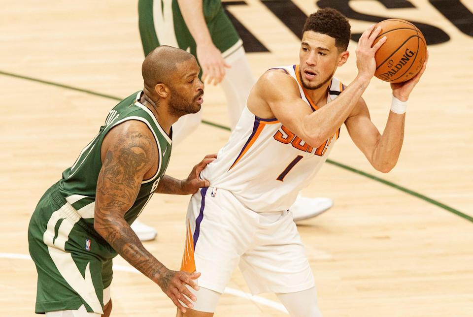 Devin Booker (1) had trouble on the offensive end in Game 3, scoring just 11 points.