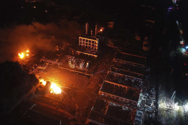 In this Thursday, March 21, 2019, aerial photo released by China's Xinhua News Agency, fires burn at the site of a factory explosion in a chemical industrial park in Xiangshui County of Yancheng in eastern China's Jiangsu province. The local government reports the death toll in an explosion at a chemical plant in eastern China has risen with dozens killed and more seriously injured. (Ji Chunpeng/Xinhua via AP)