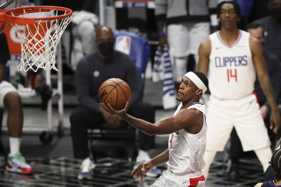 Rajon Rondo #4 of the LA Clippers drives to the basket against the Toronto Raptors in the first half at Staples Center on May 04, 2021 in Los Angeles, California. NOTE TO USER: User expressly acknowledges and agrees that, by downloading and or using this photograph, User is consenting to the terms and conditions of the Getty Images License Agreement. (Photo by Meg Oliphant/Getty Images)