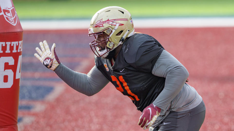American Team defensive lineman Marvin Wilson of Florida State (21) needed a bigger Senior Bowl week. (AP Photo/Matthew Hinton)