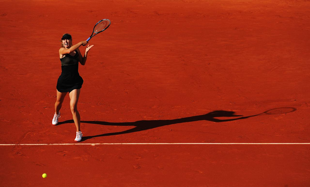 PARIS, FRANCE - JUNE 07:  Maria Sharapova of Russia plays a forehand in her women's semi final match against Petra Kvitova of Czech Republic during day 12 of the French Open at Roland Garros on June 7, 2012 in Paris, France.  (Photo by Mike Hewitt/Getty Images)