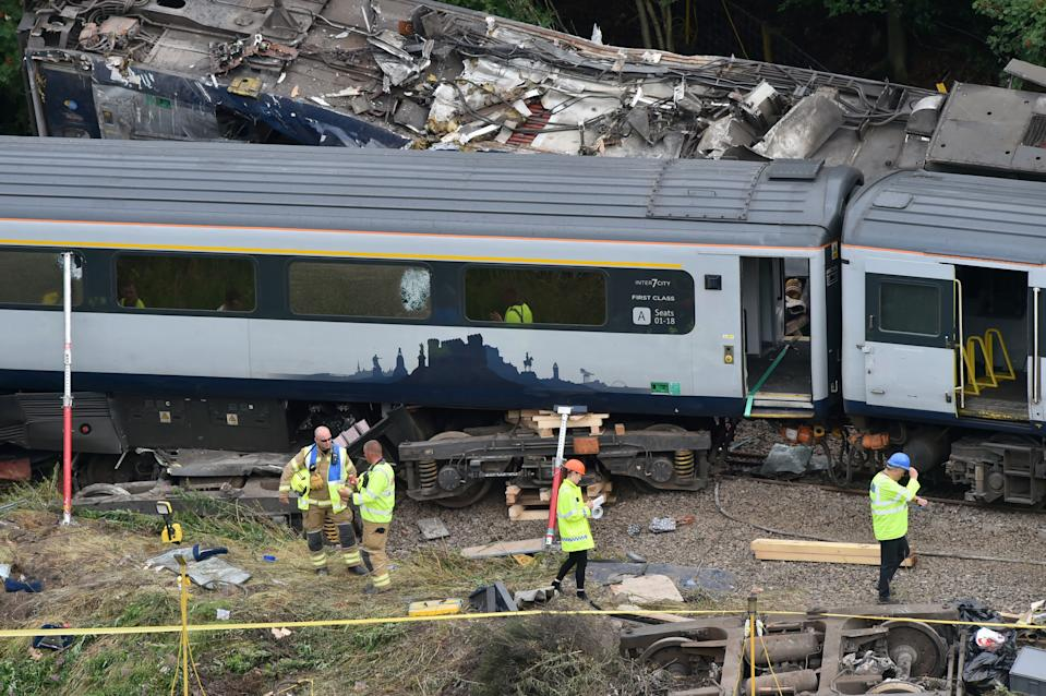 Emergency services inspect the site, following the derailment of the ScotRail train which cost the lives of three people, near Stonehaven, Aberdeenshire, Scotland, Britain August 13, 2020. Ben Birchall/Pool via REUTERS