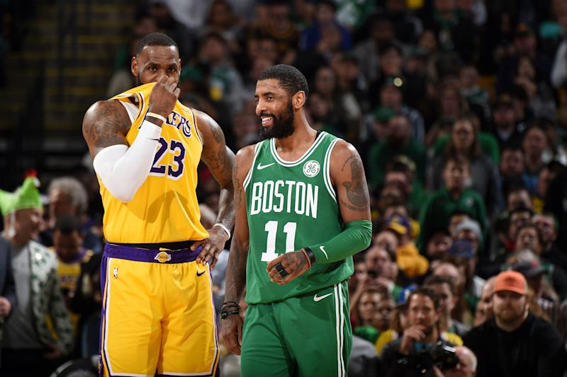 BOSTON, MA - FEBRUARY 7: LeBron James #23 of the Los Angeles Lakers and Kyrie Irving #11 of the Boston Celtics talk during the game on February 7, 2019 at the TD Garden in Boston, Massachusetts. NOTE TO USER: User expressly acknowledges and agrees that, by downloading and/or using this photograph, user is consenting to the terms and conditions of the Getty Images License Agreement. Mandatory Copyright Notice: Copyright 2019 NBAE (Photo by Brian Babineau/NBAE via Getty Images)