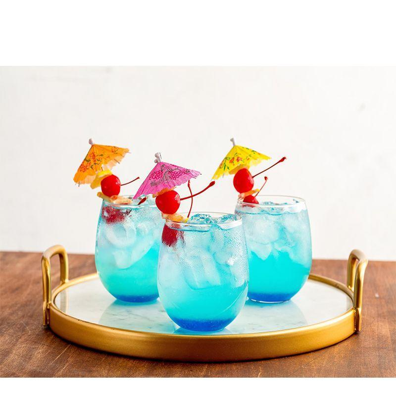 """<p>Your guests will be feeling anything but blue after they have one of these rum-based lemonade cocktails. </p><p><em><strong>Get the recipe at <a href=""""https://www.delish.com/cooking/recipe-ideas/recipes/a53044/mermaid-lemonade-recipe/"""" rel=""""nofollow noopener"""" target=""""_blank"""" data-ylk=""""slk:Delish"""" class=""""link rapid-noclick-resp"""">Delish</a>.</strong></em></p>"""