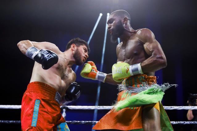 Jaron Ennis, right, throws a right against Bakhtiyar Eyubov during the third round of their boxing bout in Atlantic City, N.J., Friday, Jan. 10, 2020. (AP Photo/Matt Rourke)