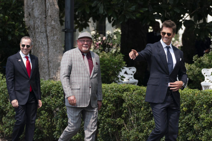 Tampa Bay Buccaneers quarterback Tom Brady, head coach Bruce Arians and Buccaneers co-owner Bryan Glazer, arrive for a ceremony on the South Lawn of the White House, in Washington, Tuesday, July 20, 2021, where President Joe Biden honored the Super Bowl Champion Tampa Bay Buccaneers for their Super Bowl LV victory. (AP Photo/Manuel Balce Ceneta)