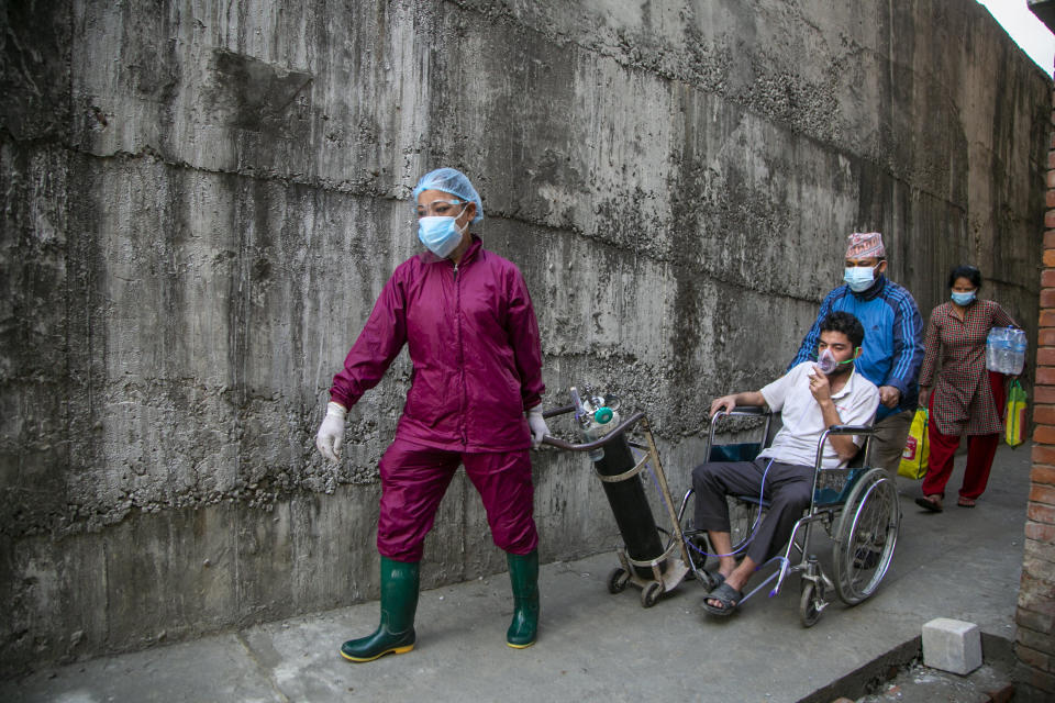 A COVID-19 patient arrives at a hospital in Kathmandu, Nepal, Thursday, May 6, 2021. Nepal's main cities and towns including the capital Kathmandu has been in lockdown since last month as the number coronavirus cases and deaths continue to rise. (AP Photo/Niranjan Shrestha)
