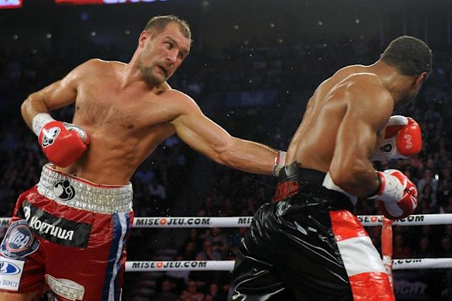 Sergey Kovalev lands a body shot on Jean Pascal during their unified light heavyweight championship bout in March 2015. (AFP)