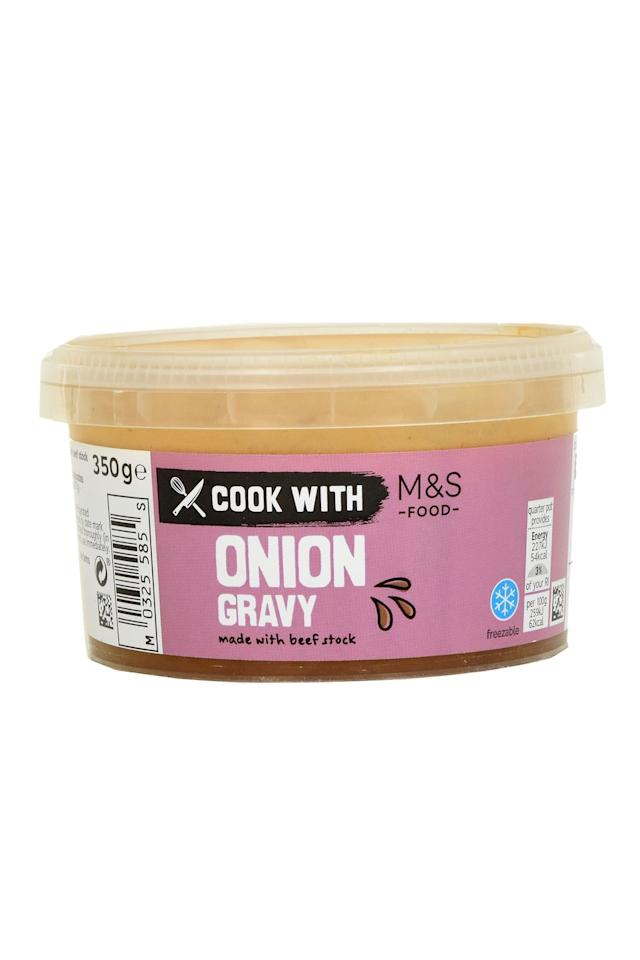 """<p><strong>Overall Score: 81/100</strong><br></p><p>With slices of softened onions in a rich, glossy sauce, this gravy has a heartily comforting, beefy aroma. Testers enjoyed the well-rounded balance of flavours from the rich, salty beef stock and the sweetness from the onions.</p><p><strong><a class=""""body-btn-link"""" href=""""https://go.redirectingat.com?id=127X1599956&url=https%3A%2F%2Fwww.ocado.com%2Fproducts%2Fcook-with-m-s-onion-gravy-519747011&sref=https%3A%2F%2Fwww.goodhousekeeping.com%2Fuk%2Ffood%2Ffood-reviews%2Fg30676978%2Fbest-onion-gravy%2F"""" target=""""_blank"""">BUY NOW</a> Ocado, £2 for 350g</strong></p>"""