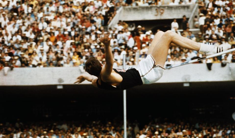 """<p>United States high jumper, Dick Fosbury, is recognized as revolutionizing the high jump competition with his <a href=""""https://www.worldathletics.org/news/feature/dick-fosbury-flop"""" rel=""""nofollow noopener"""" target=""""_blank"""" data-ylk=""""slk:unusual technique"""" class=""""link rapid-noclick-resp"""">unusual technique</a> in Mexico City. The backwards layout-style jump, dubbed the Fosbury Flop, led him to a gold medal victory. </p>"""