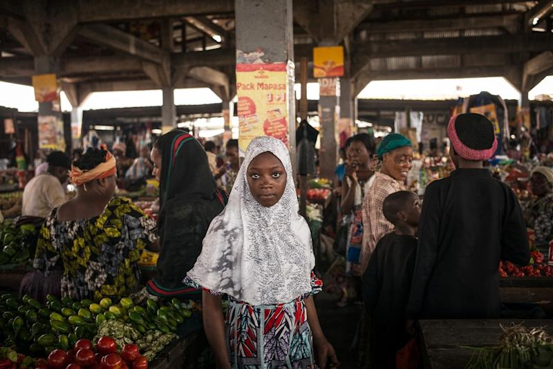 A Muslim woman is seen shopping in the popular district of Poto Poto market on July 22, 2015, in Brazzaville