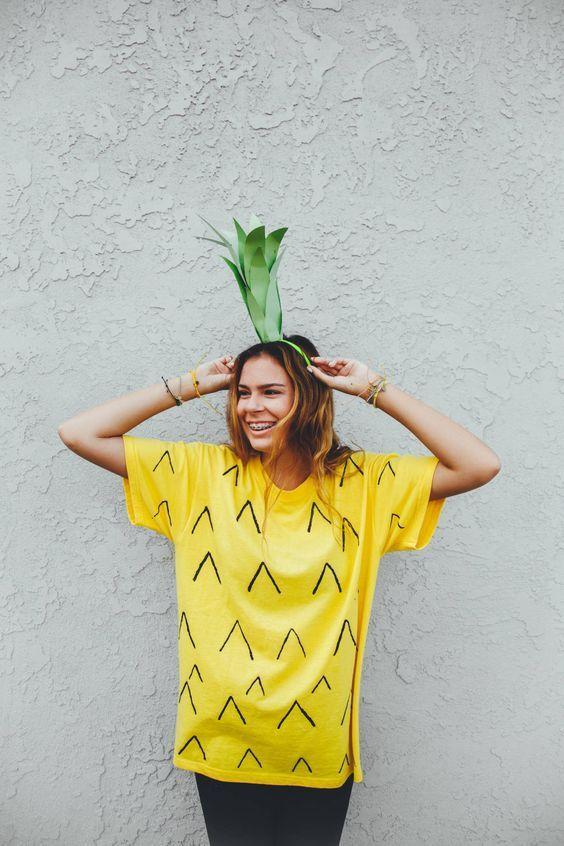 """<p>Grab a Sharpie and get to work turning a basic yellow T-shirt into a tropical fruit! </p><p><strong>Get the tutorial at <a href=""""http://blog.puravidabracelets.com/be-a-pineapple-halloween-costume-diy"""" rel=""""nofollow noopener"""" target=""""_blank"""" data-ylk=""""slk:The Pura Vida Bracelets"""" class=""""link rapid-noclick-resp"""">The Pura Vida Bracelets</a>.</strong></p><p><a class=""""link rapid-noclick-resp"""" href=""""https://www.amazon.com/s/ref=nb_sb_noss_2?url=search-alias%3Dfashion&field-keywords=yellow+t+shirt&tag=syn-yahoo-20&ascsubtag=%5Bartid%7C10050.g.21603260%5Bsrc%7Cyahoo-us"""" rel=""""nofollow noopener"""" target=""""_blank"""" data-ylk=""""slk:SHOP YELLOW T-SHIRTS"""">SHOP YELLOW T-SHIRTS</a></p>"""