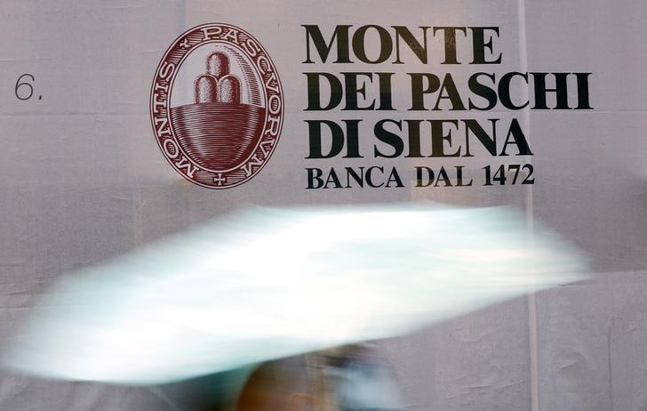 A panel with logo of Monte dei Paschi di Siena bank is seen in downtown Siena