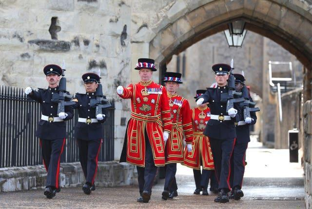 A march towards the West Door at the Tower of London