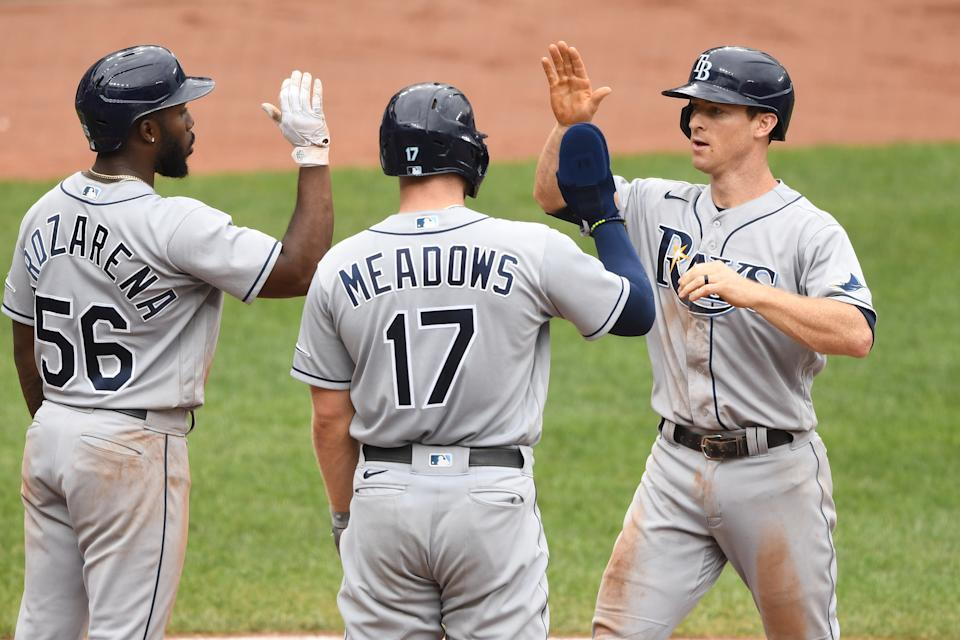 Joey Wendle of the Tampa Bay Rays celebrates with teammates Randy Arozarena and Austin Meadows after hitting a grand slam in a win over the Orioles. (Photo by Mitchell Layton/Getty Images)