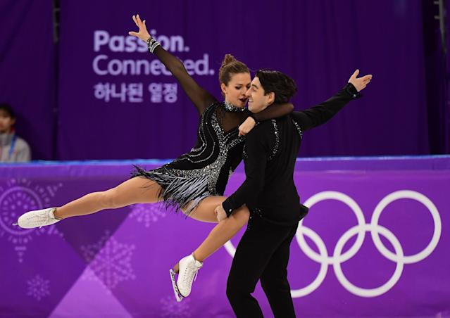 <p>Turkey's Alper Ucar and Turkey's Alisa Agafonova compete in the ice dance short dance of the figure skating event during the Pyeongchang 2018 Winter Olympic Games at the Gangneung Ice Arena in Gangneung on February 19, 2018. / AFP PHOTO / Roberto SCHMIDT </p>