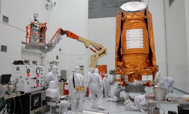 The Kepler spacecraft is fueled up inside a processing facility in Florida prior to its 2009 launch.