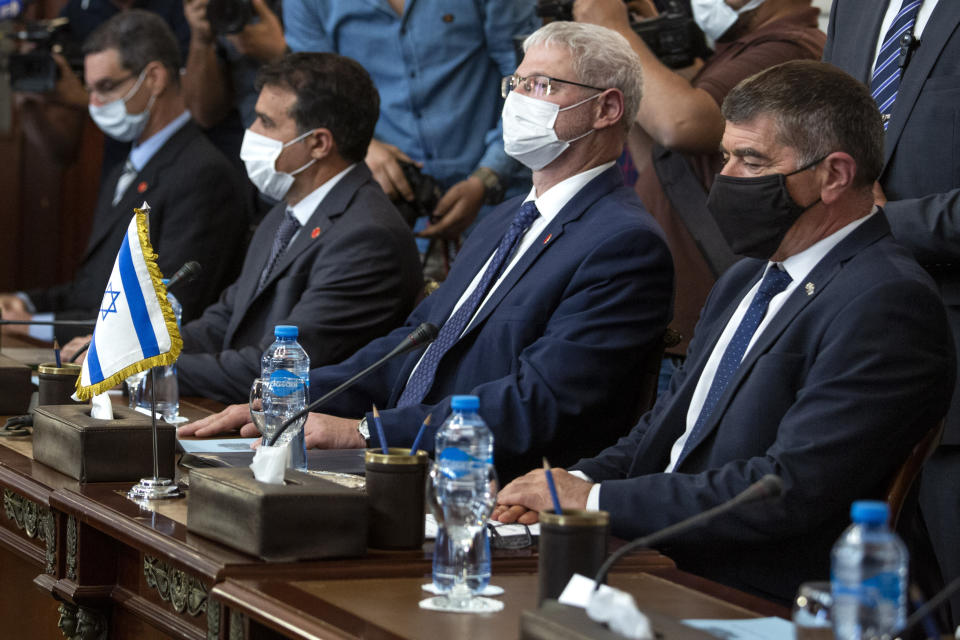 Israeli Foreign Minister Gabi Ashkenazi, right, meets with Egyptian Foreign Minister Sameh Shoukry (not shown), during high-level talks to shore up a fragile truce between Israel and the Hamas militant group at the Tahrir Palace in Cairo, Egypt, Sunday, May 30, 2021. (AP Photo/Nariman El-Mofty)