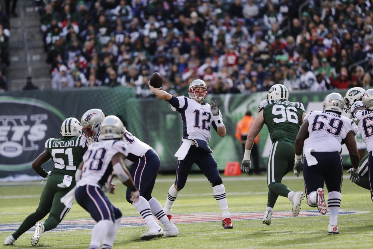 New England Patriots quarterback Tom Brady became the all-time combined passing yards leader on Sunday. (AP)