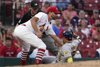 St. Louis Cardinals' Adam Wainwright reaches for the ball as Milwaukee Brewers' Kolten Wong, right, is safe after advancing to third on a throwing error by Cardinals shortstop Edmundo Sosa during the second inning of a baseball game Tuesday, Aug. 17, 2021, in St. Louis. (AP Photo/Jeff Roberson)